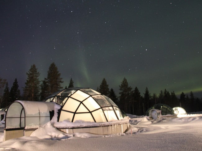 Experience the Northern Lights in a glass igloo in Finland.