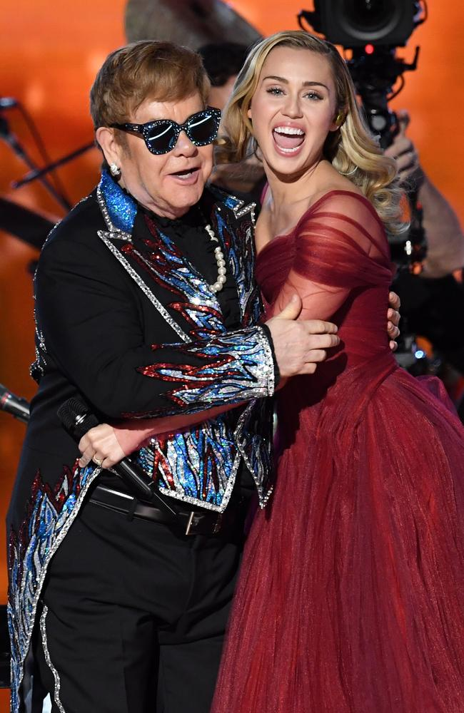 Recording artists Sir Elton John and Miley Cyrus perform onstage. Picture: Getty