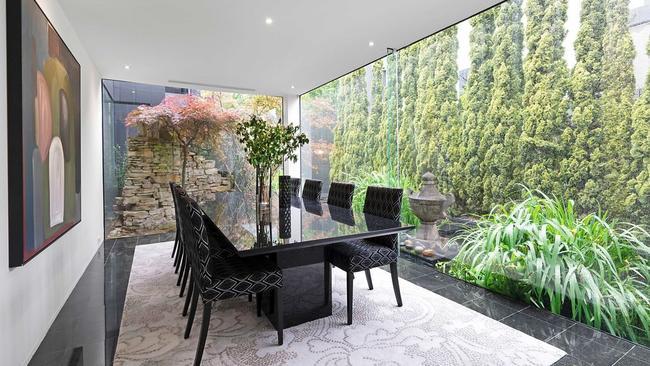 Huge windows take in the garden setting.