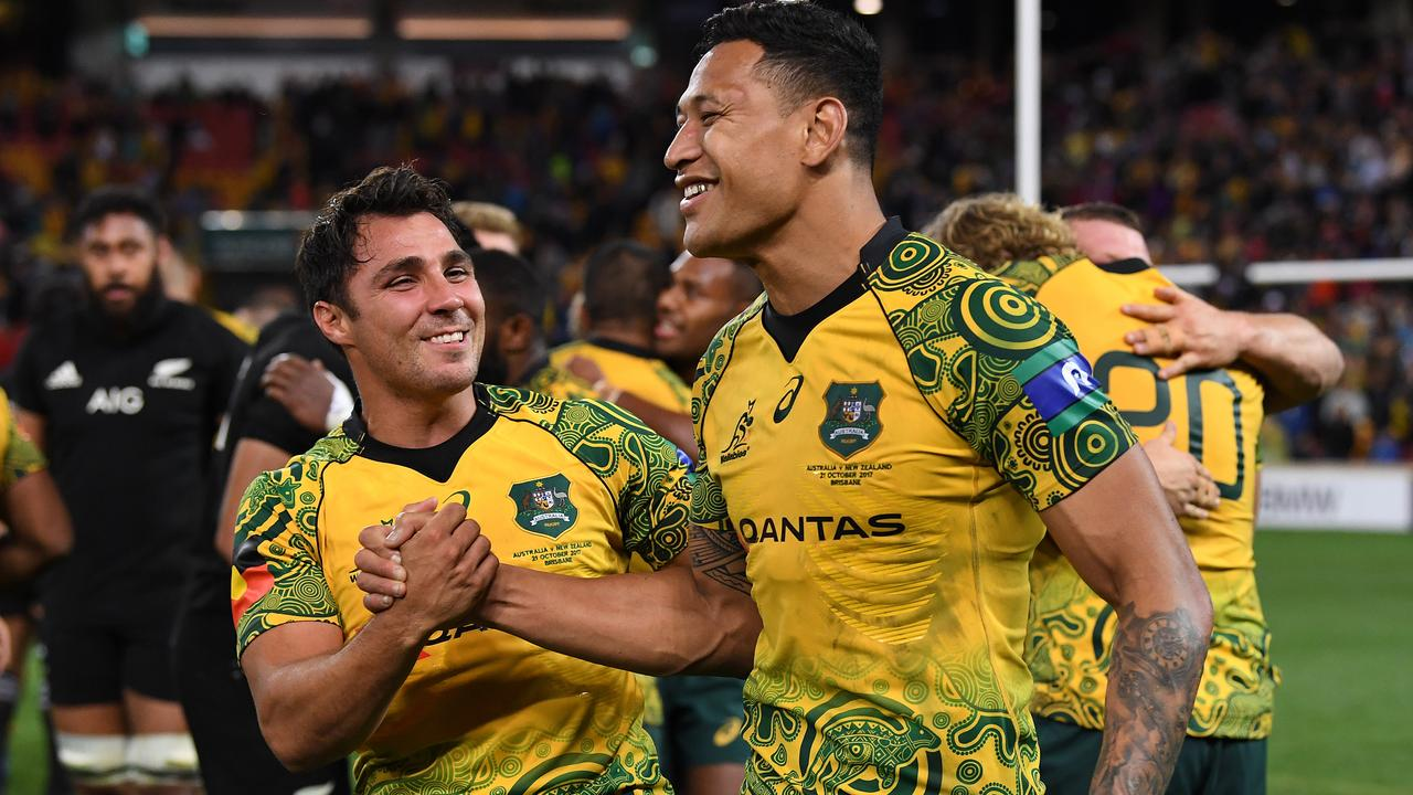Wallabies Nick Phipps and Israel Folau celebrate at Suncorp Stadium in Brisbane.