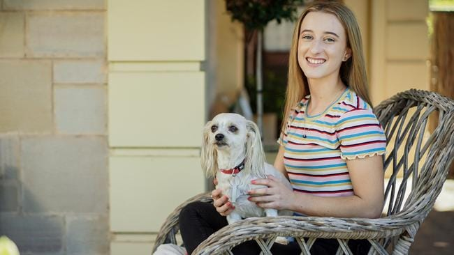 Georgie Trotter's dog Kobbie Mae features in her book about money. Picture: AAP/Mike Burton
