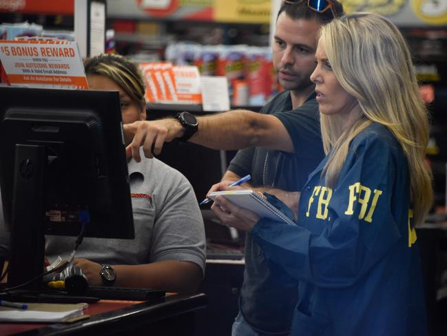 FBI agents search for clues and evidences at the Auto Zone Store in Plantation, North of Miami, on October 26, 2018 where a suspect was arrested. Picture: AFP
