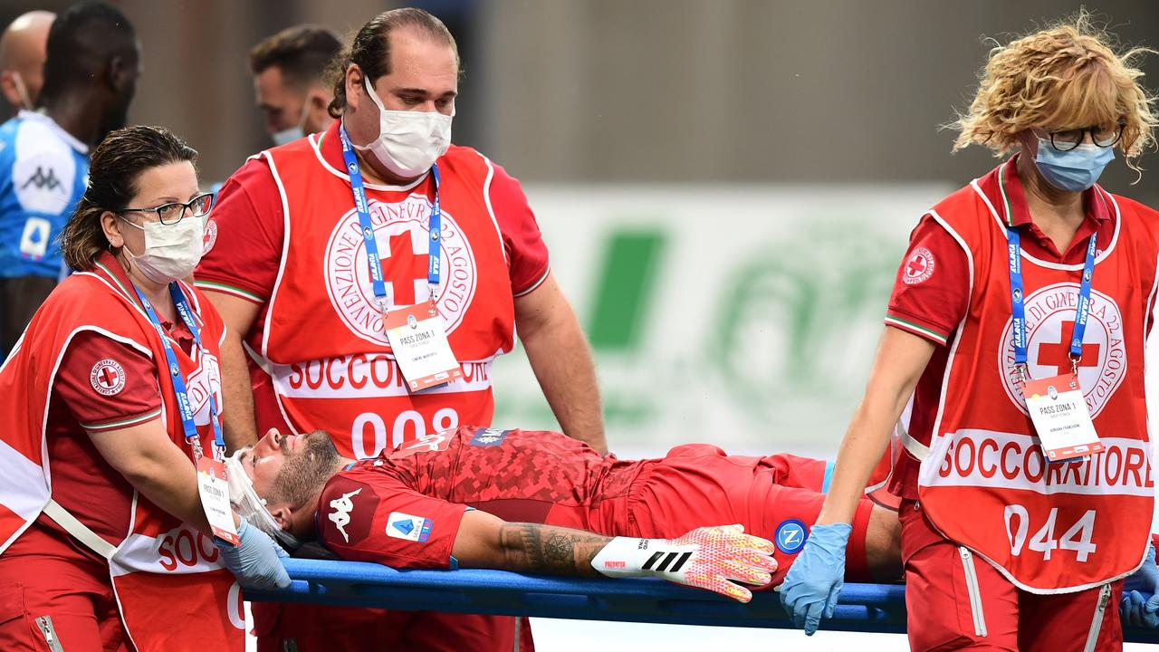 Ospina was carried off on a stretcher with his head wrapped in bandages.