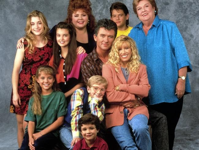 STEP BY STEP, (back l-r): Stacy Keanan, Angela Watson, Patrika Darbo, Patrick Duffy, Brandon Call, Peggy Rea, (front l-r): Christine Lakin, Christopher Castile, Suzanne Somers, Josh Byrne. Picture: Warner Bros. Television