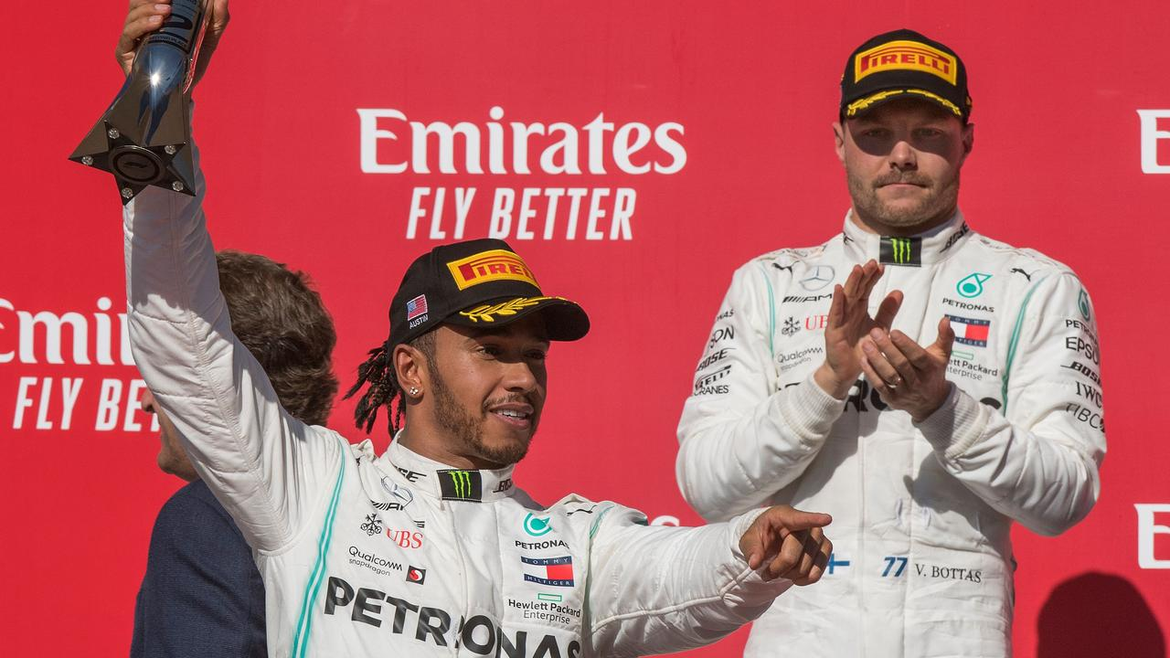 Valtteri Bottas looks on as Lewis Hamilton celebrates. Picture: Mark Ralston