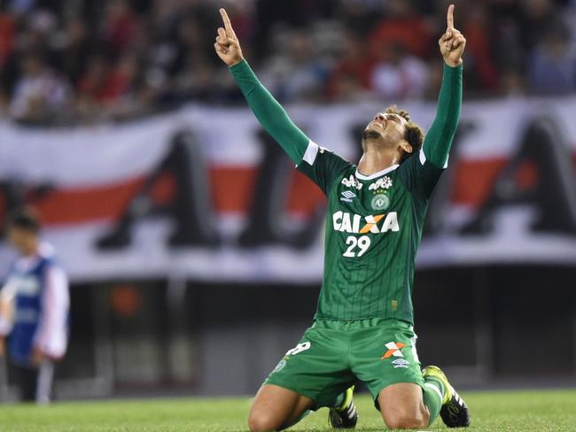 Brazil's Chapecoense defender Neto celebrating after his team scored a goal against Argentina's River Plate.