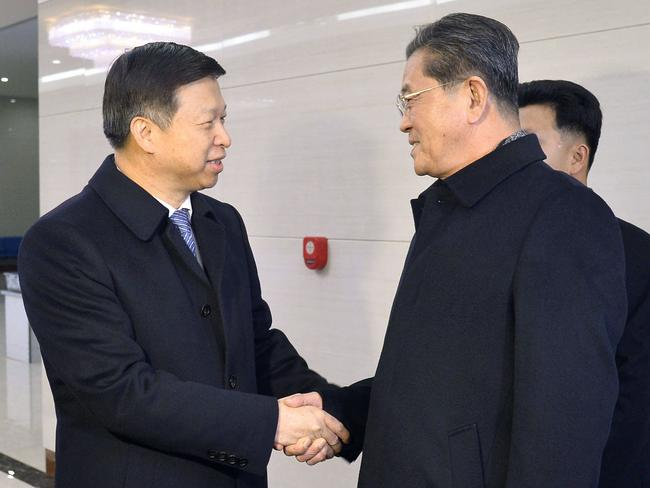 Song Tao, left, the head of China's ruling Communist Party's International Liaison Department, is greeted by Ri Chang Gun, right, vice department director of the Central Committee of North Korea's ruling party at Pyongyang International Airport. Picture: Kyodo News via AP