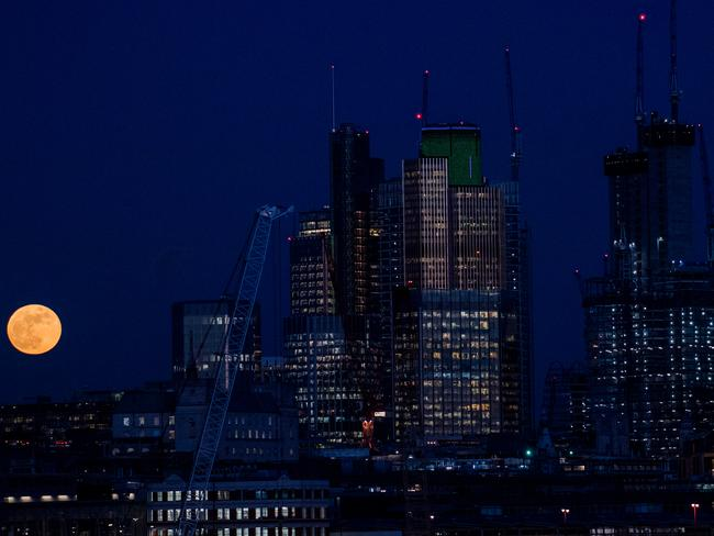 A supermoon rises behind skyscrapers in London, United Kingdom. Picture: Chris J Ratcliffe/Getty Images