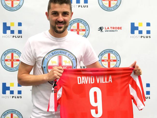 David Villa poses with the Melbourne City away jersey after confirmation of his signing to play in next season's A-League.