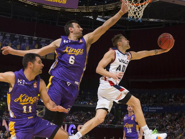 Andrew Bogut of the Kings defends against Nathan Sobey of the 36ers on Saturday. Picture:AAP