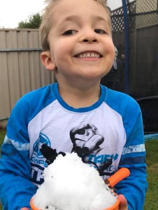 Earlier this week this little guy had a go at building snow men with hail and ice — but there may be some real snow on its way Saturday. Picture: Kelly Hough
