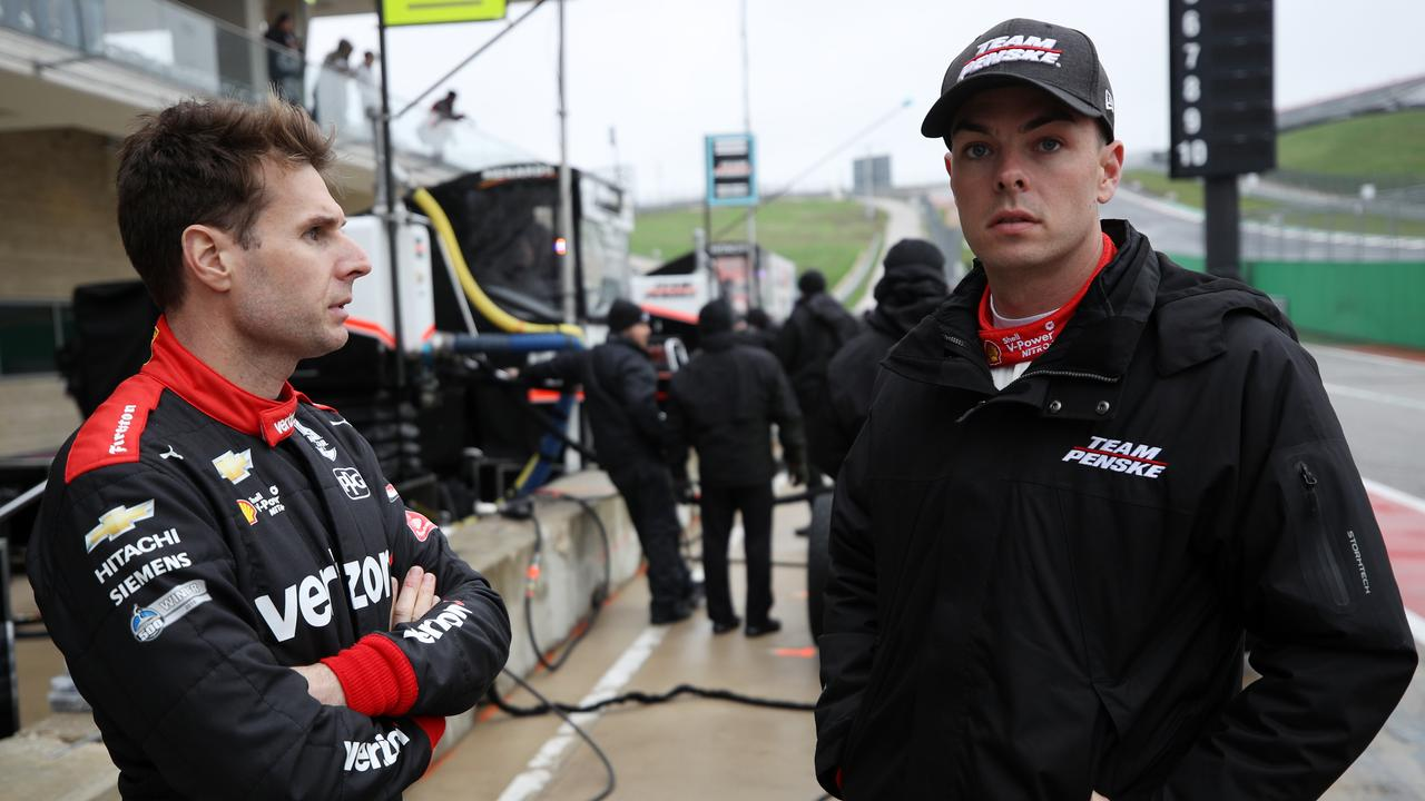 Will Power talks with Scott McLaughlin at the test.