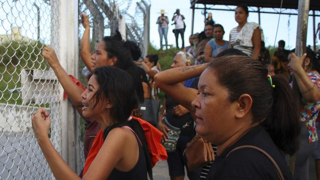 Distressed relatives gather outside the Anisio Jobim Prison Complex in Brazil on Monday. Picture: Edmar Barros