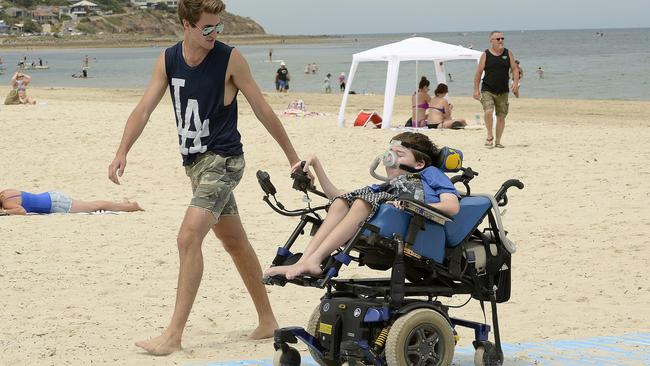Beach mat rolled out for people with disabilities, walking frames ...