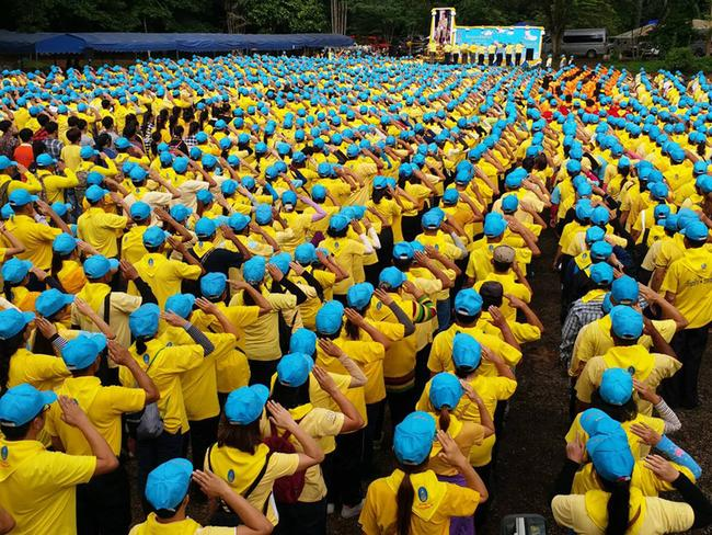 Volunteers gather for a ceremony before the clean up operation at the Tham Luang cave area.