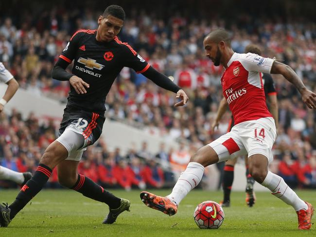 Manchester United's Chris Smalling (L).