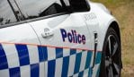 A woman will face court after spitting on a supermarket worker in New South Wales.