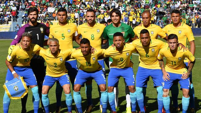Brazil pose for a team photo with Bolivia's striker.