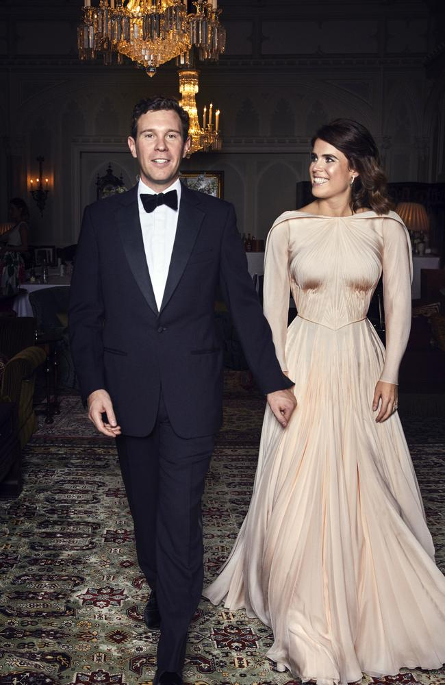 Princess Eugenie, wearing a Zac Posen gown inspired by the white rose of York, and Jack Brooksbank are pictured at Royal Lodge, Windsor. Picture: Alex Bramall