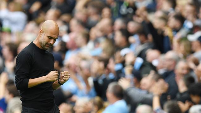 Manchester City's Spanish manager Pep Guardiola celebrates their second goal