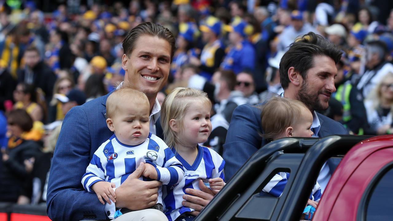 Andrew Swallow and Jarrad Waite do a lap before last year's grand final at the MCG.