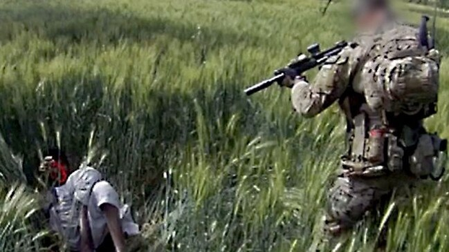 The SAS 'Soldier C' trains his assault rifle on the Afghani man cornered in a wheat field. Picture: Four Corners