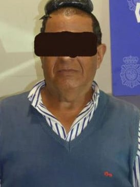 Officers discovered nearly $48,000 worth of cocaine stashed inside the man's wig. Source: Twitter/POLICIA NACIONAL