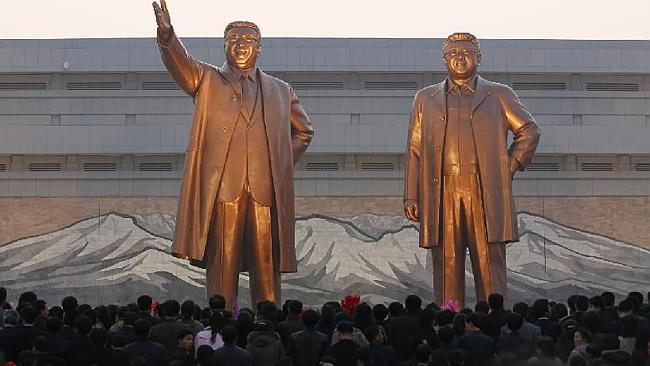 Creepy: not only do Kim Jong-un's dad and grandpa dominate public artworks, their bodies life embalmed in a Pyongyang palace. Picture: AP.