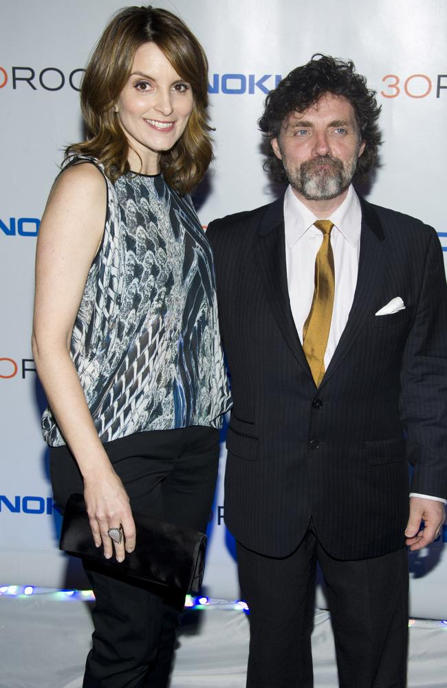 Tina Fey and her husband Jeff Richmond both are said to be 165cm, but the photos (and perhaps some very high heels) say otherwise. Picture: AP