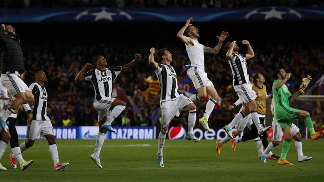 Juventus players celebrate winning after the UEFA Champions League quarter-final.