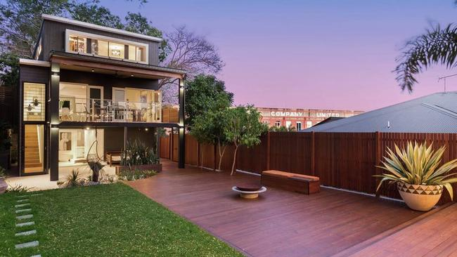 This four-bedroom house at 14 Mackellar St, Teneriffe, is for sale for $1.9m to $2.1m.