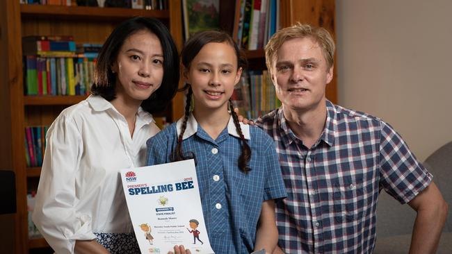 Hannah Moore, 10, with her parents Kevin and Joy. Hannah, who attends Hornsby South Public School, won the title of Junior State Spelling Bee champion in the 2019 Premier's competition. Picture: AAP