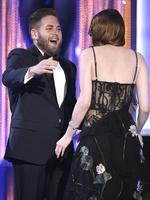 "Jonah Hill presents Emma Stone with the award for outstanding performance by a female actor in a leading role for ""La La Land"" at the 23rd Annual Screen Actors Guild Awards. Picture: AP"