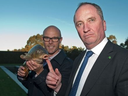 Former deputy prime minister Barnaby Joyce with 'Carpinator' Matt Barwick, and the carp. Picture: Supplied