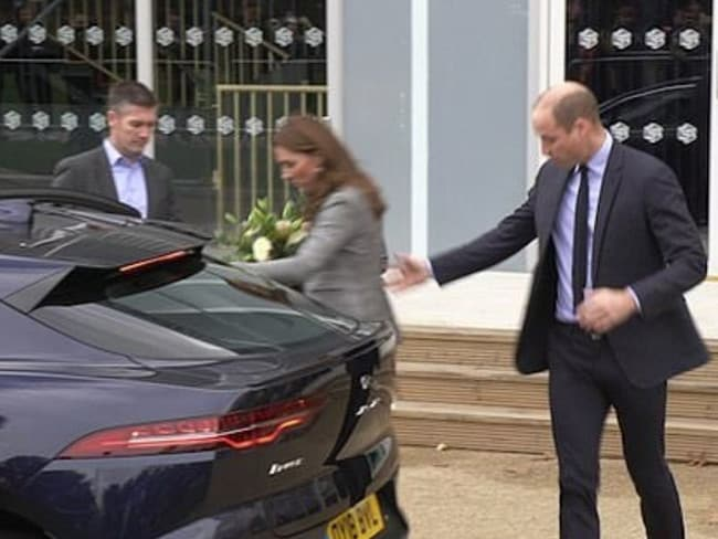 Prince William reached out to help his wife after she appeared to trip over on her way into her car after attending a charity event in London. Picture: YouTube