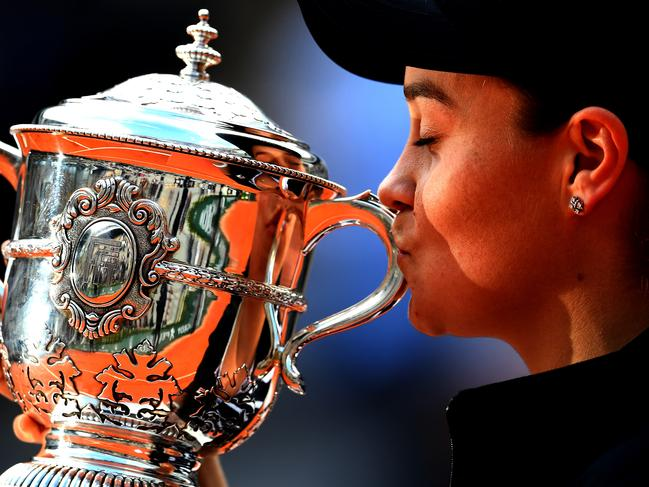 Barty kisses the French Open trophy after defeating Marketa Vondrousova 6-1 6-3 in under an hour. Picture: Clive Mason