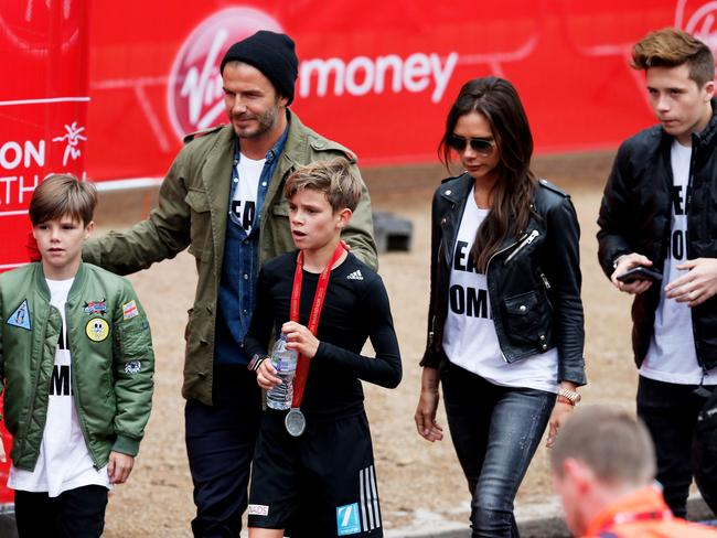 Beckhams on the move? Romeo (centre), brother Cruz (left), dad David (second left), mum Victoria (second right) and Brooklyn (right) in London. Picture: Steve Bardens/Getty Images