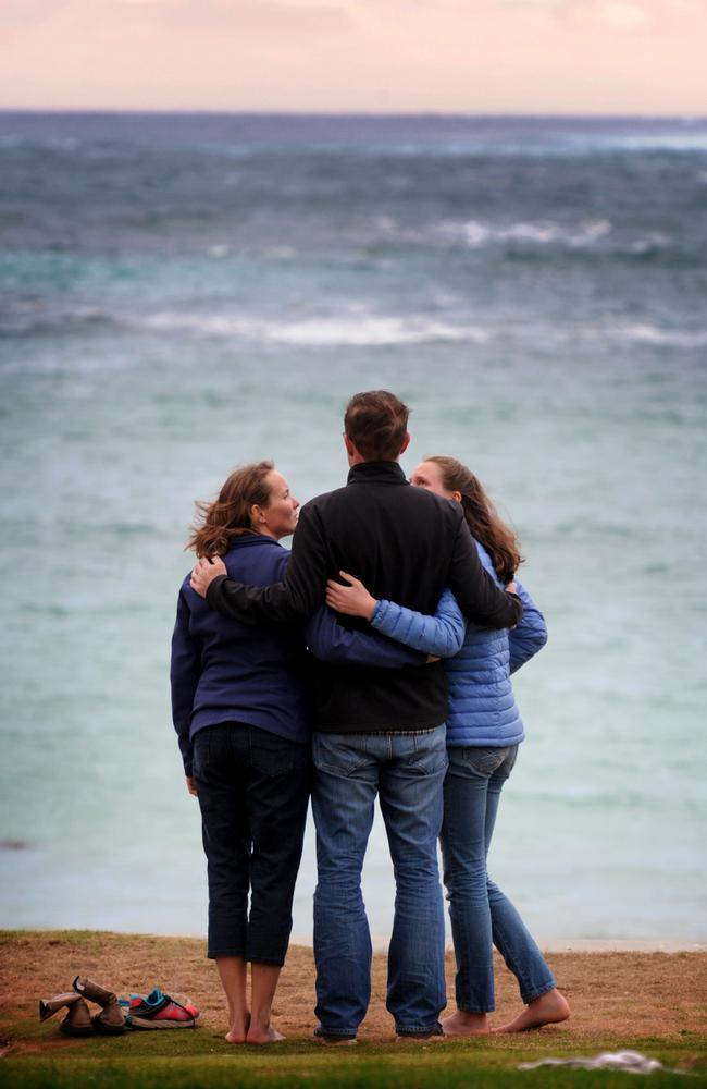 Friends of Port Campbell SLSC gathered to mourn the two lifeguards who drowned on Sunday. Picture: Andrew Henshaw