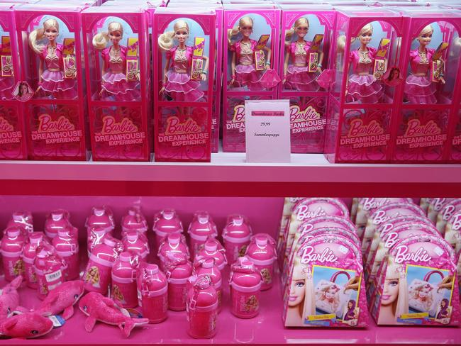 Like many 'girlie' toys, Barbie dolls are often displayed using bright pick packaging. Picture: Sean Gallup/Getty Images.