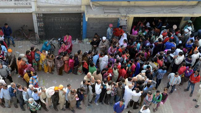 Indian people queue outside a bank as they wait to deposit and exchange 500 and 1000 rupee notes in Amritsar on November 13. Picture: Narinder Nanu/AFP