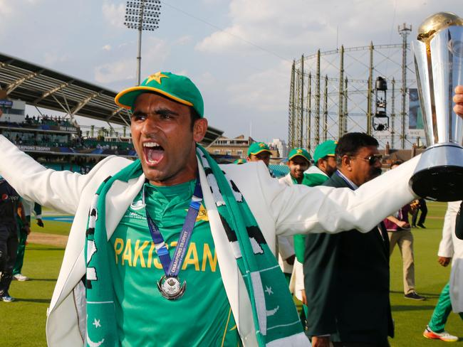 Pakistan's Fakhar Zaman holds the trophy after his brilliant century.