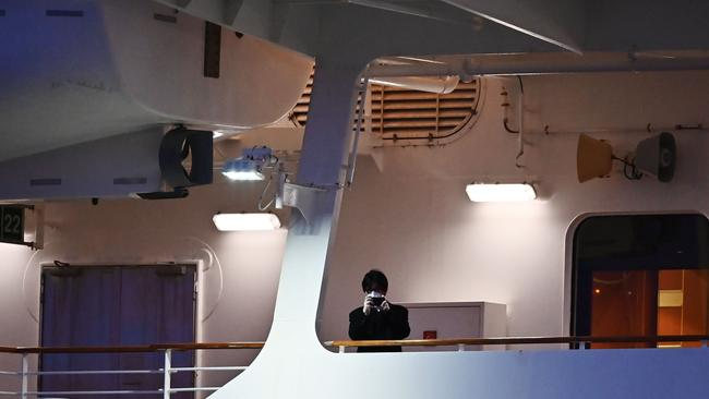 Crew also had to remain on the ship. Picture: AFP/CHARLY TRIBALLEAU