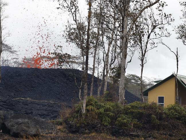A house is seen next to a erupting lava fissure on Pohoiki Rd, near Pahoa, Hawaii. Picture: AP