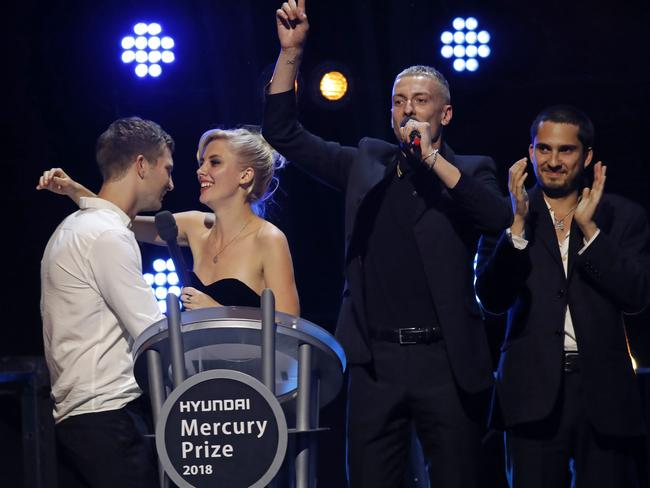 Joff Oddie, Ellie Rowsell, Theo Ellis and Joel Amey of Wolf Alice win the 2018 Mercury Music prize for their album Visions of a Life in London. Picture: Tolga Akmen / AFP