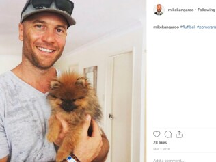 """""""Behold me with this adorable canine; the physical embodiment of my kind and caring side."""" Source: Instagram"""