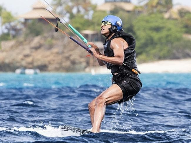 Former US President Barack Obama kitesurfs during his stay on Moskito Island, British Virgin Islands. Picture: AP