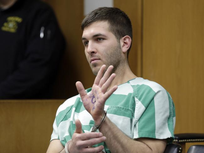 Anthony Comello displays writing on his hand that includes pro-Donald Trump slogans during his extradition hearing over the killing of the reputed boss of New York's Gambino crime family, Francesco Cali. Picture: AP