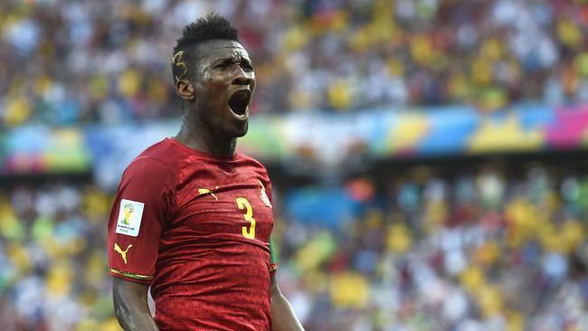 Asamoah Gyan of Ghana celebrates scoring his team's second goal against Germany.
