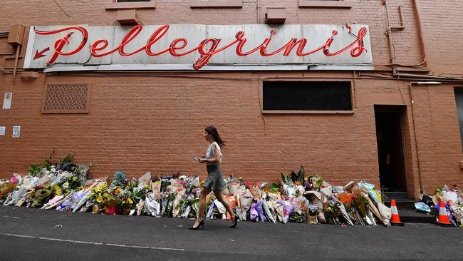 People pay their respects at Pellegrini's Espresso Bar after owner Sisto Malaspina was killed during a terrorist attack. Picture: Jake Nowakowski