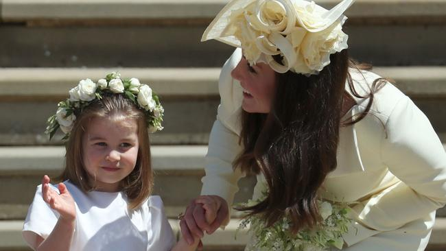 The little princess waved at fans while gripping her mother's hand. Credit: AFP Photo/Pool/Jane Barlow